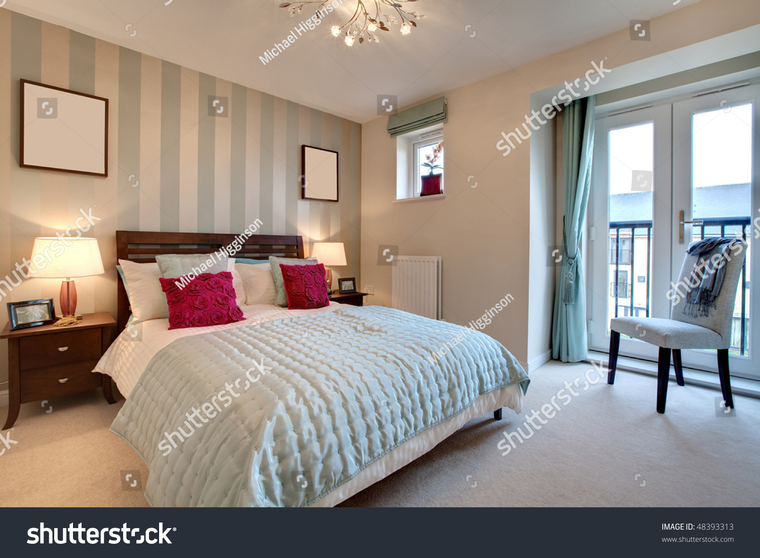 stylish modern adult bedroom including bed dressed with