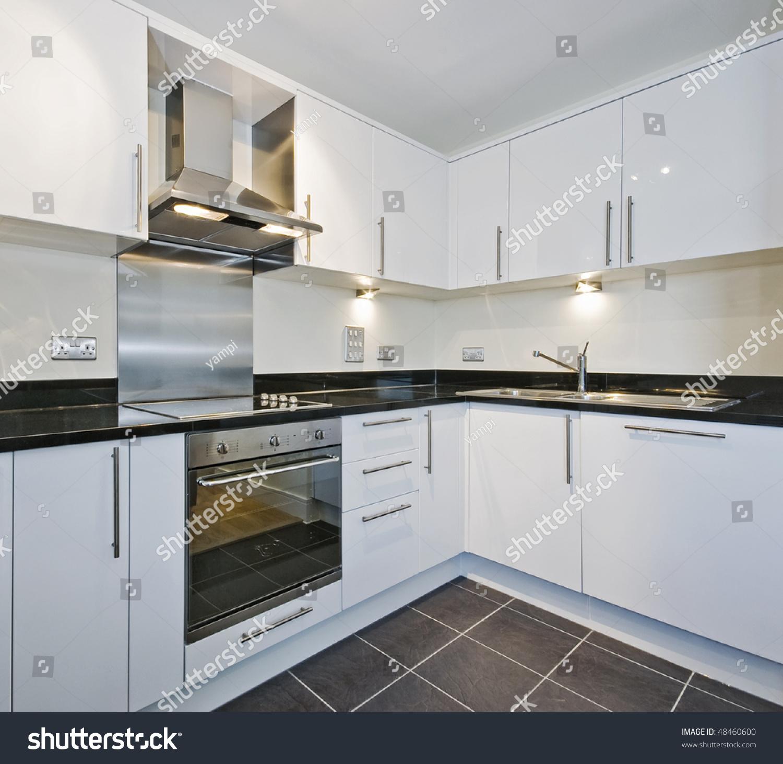 Modern White Kitchen Black Granite Worktop Stock Photo