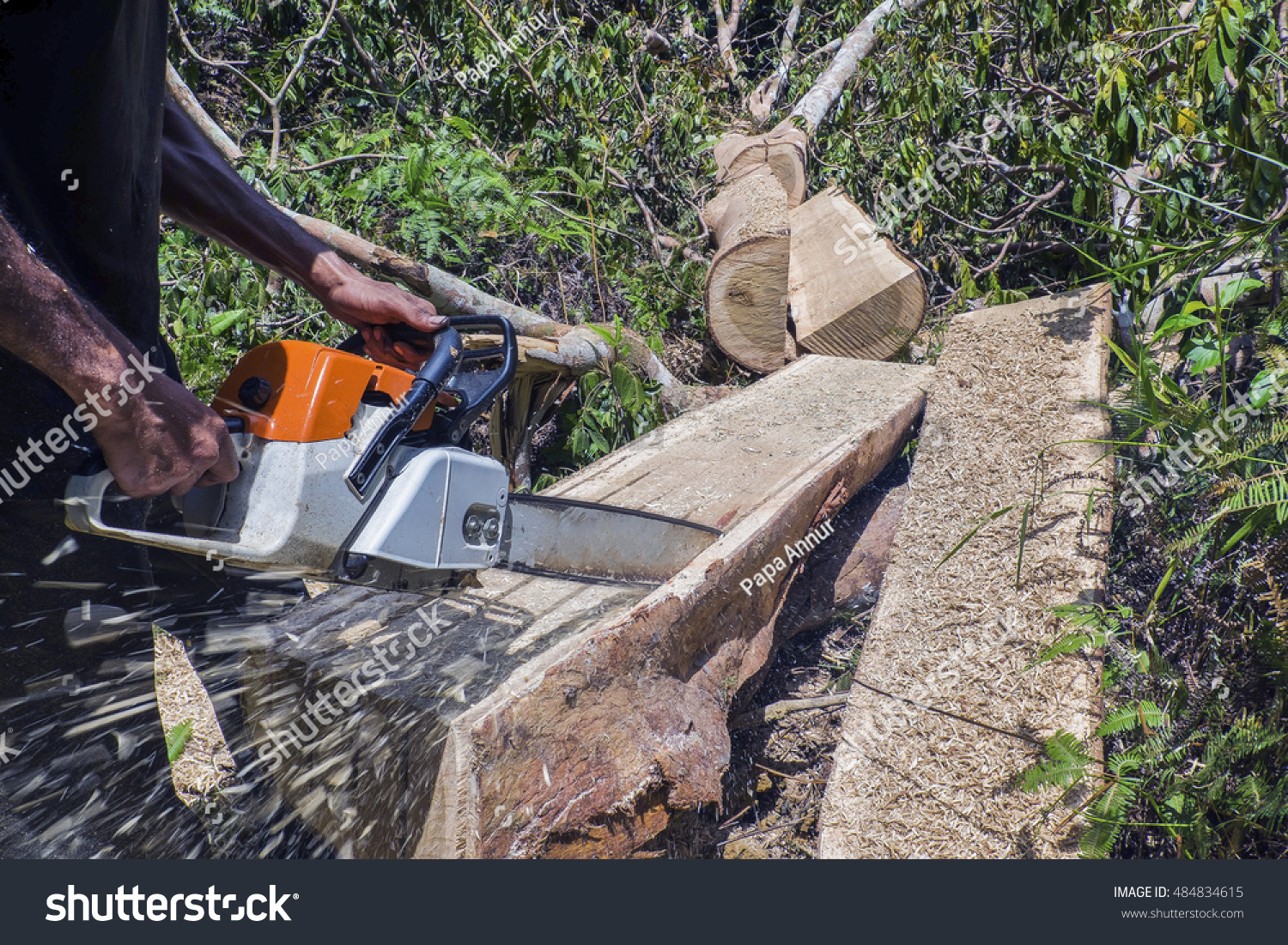 how to cut a log flat with a chainsaw
