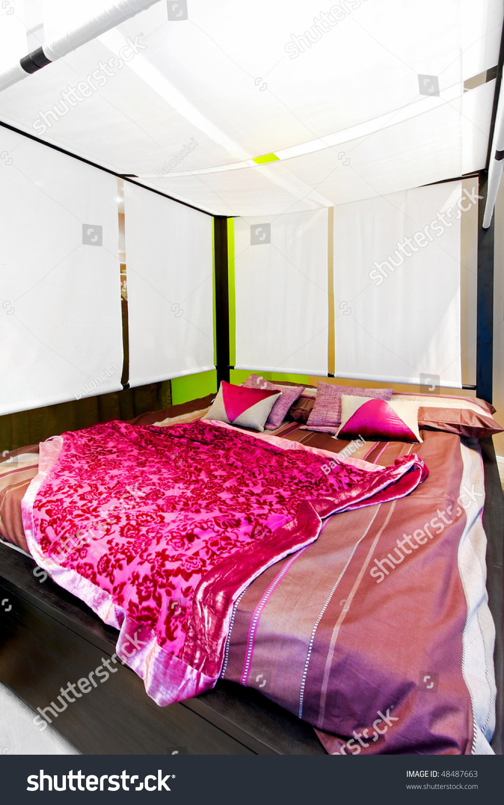 Interior Of Bedroom With Big Canopy Bed Stock Photo