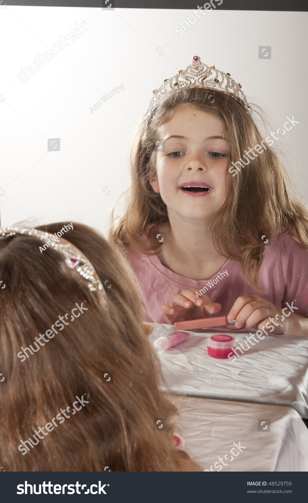 Little Girl Looking Herself Mirror While Stock Photo -6315