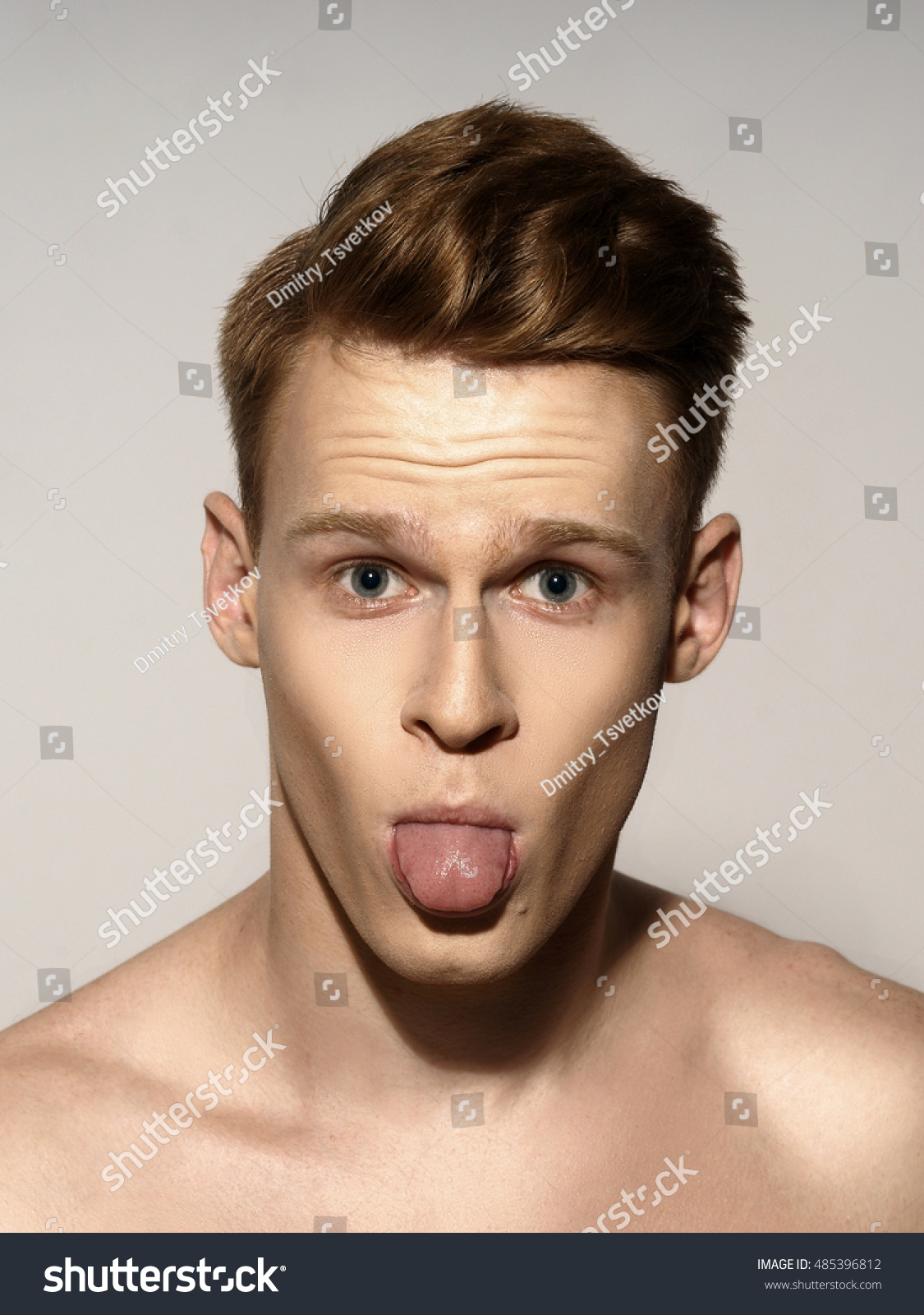 Studio Fashion Style Closeup Face Portrait Of Young Emotional Man Looking In Camera And Showing