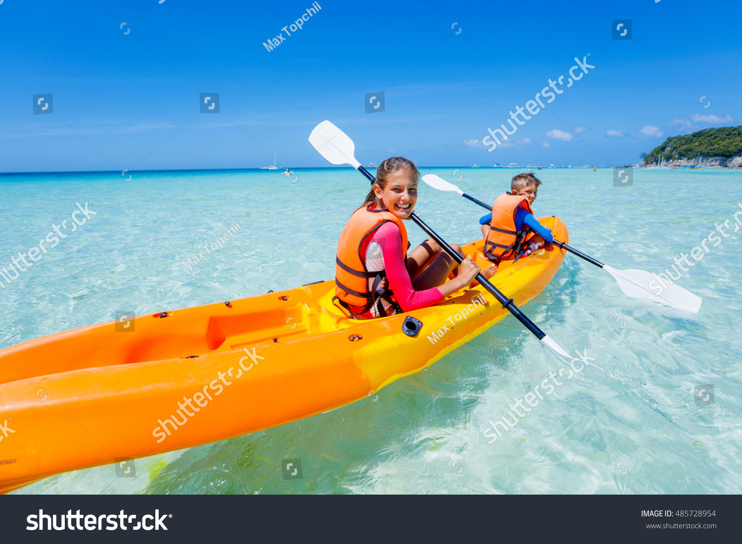 Kids Enjoying Paddling Orange Kayak Tropical Stock Photo