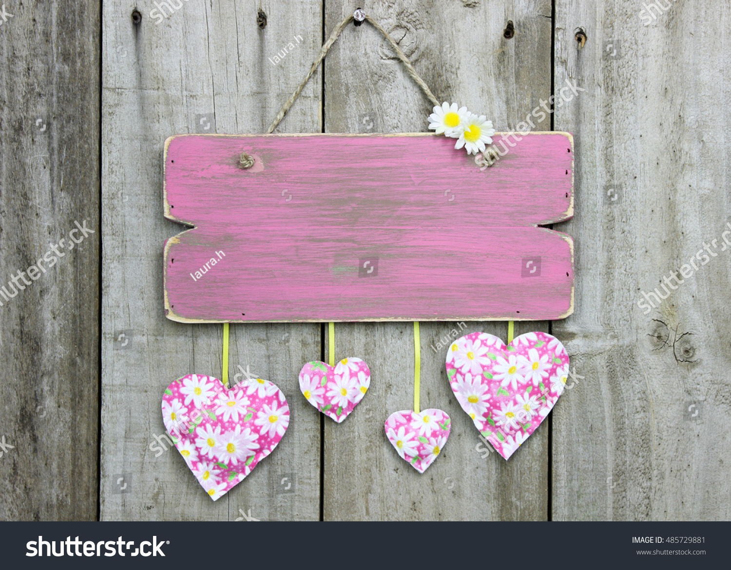 Blank Rustic Pink Sign With White And Yellow Daisy Hearts Hanging On Antique Aged Wooden Background