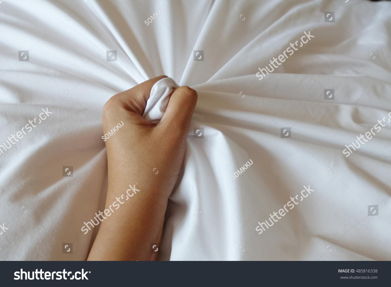 Woman orgasm on satin sheets