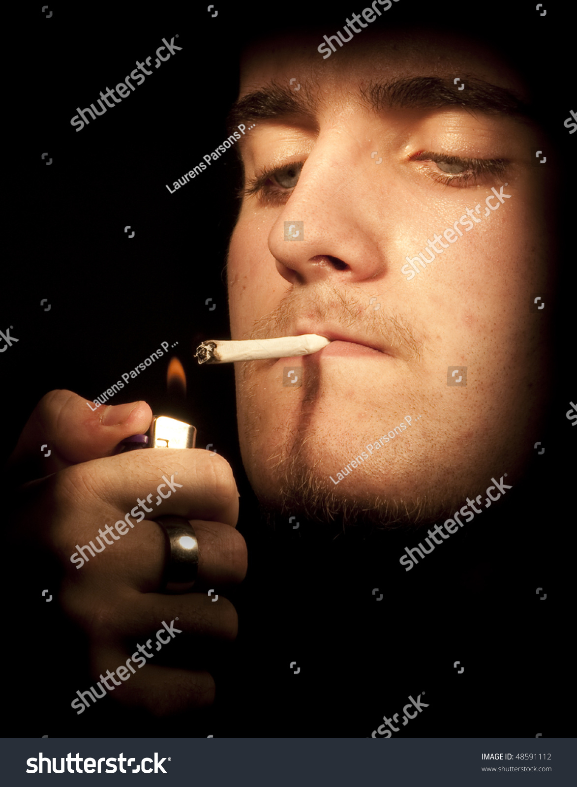 Young man lighting a cigarette. Focus emphasis on lighter and flame held in hand  sc 1 st  Shutterstock & Young Man Lighting Cigarette Focus Emphasis Stock Photo 48591112 ... azcodes.com