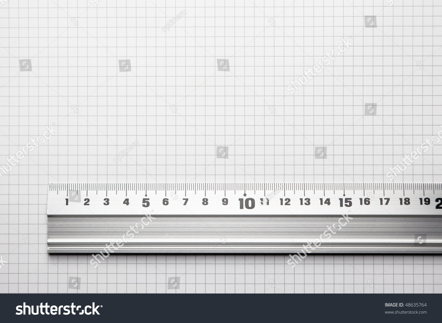 Ruler Aligned To A Scaled Paper. For Showing Actual Size Of A ...