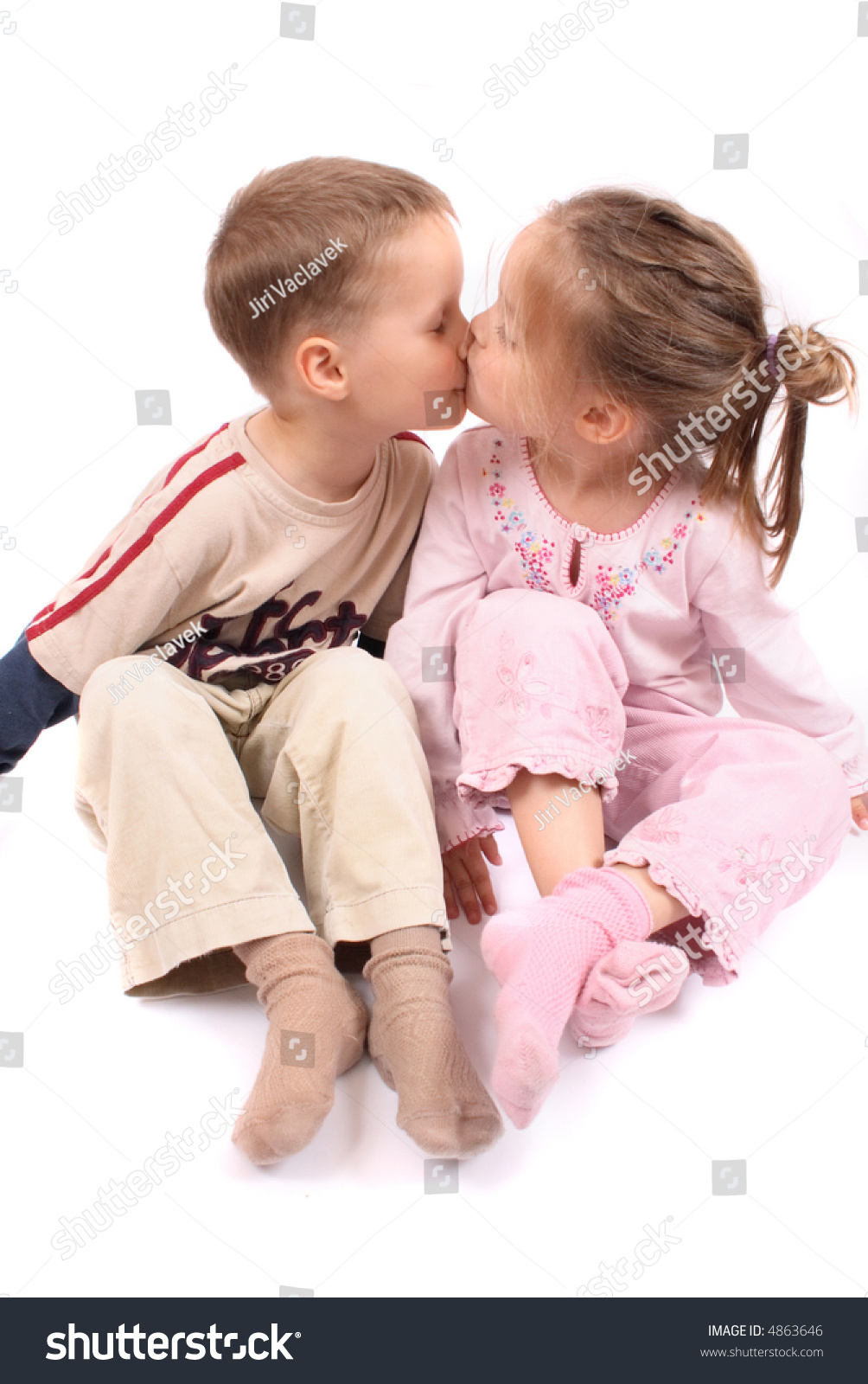 Boy Girl Kissing Each Other Stock Photo 4863646 - Shutterstock-5107
