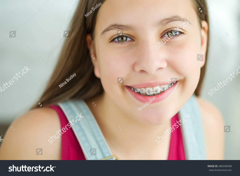 portrait cute kid dental braces smiling stock photo (edit now