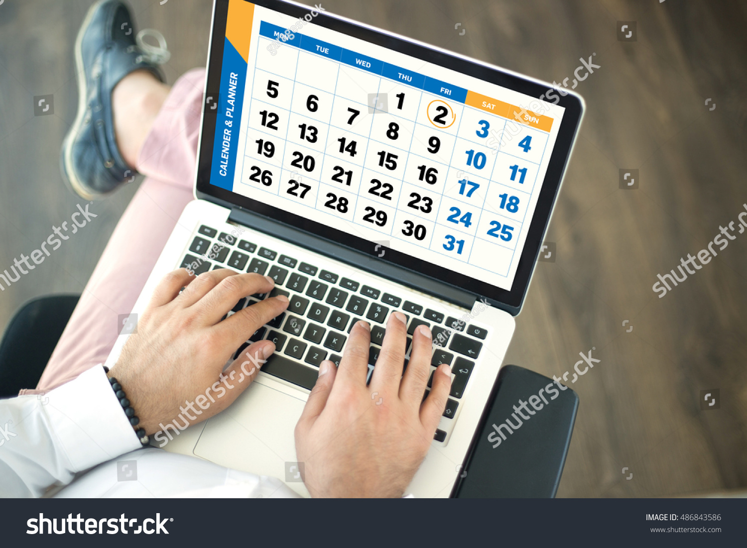 Calendar Planner For Laptop : People using laptop monthly planner calendar stock photo