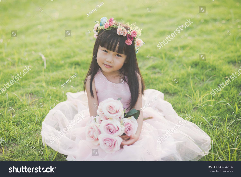 Beautiful vietnamese baby girl flower crown stock photo royalty beautiful vietnamese baby girl with flower crown on grass izmirmasajfo