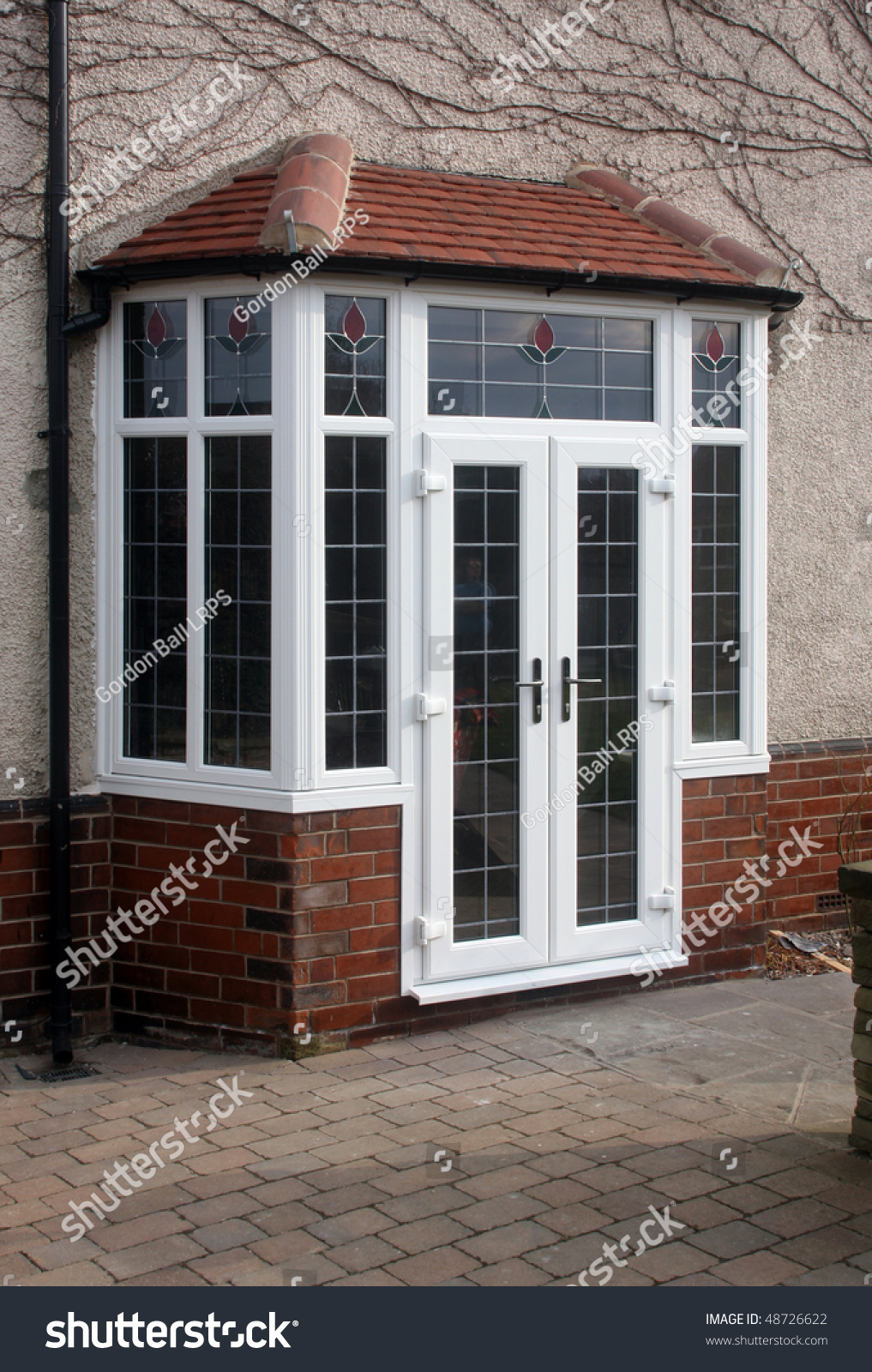 Upvc french doors fitted in bay stock photo 48726622 for Upvc doors fitted