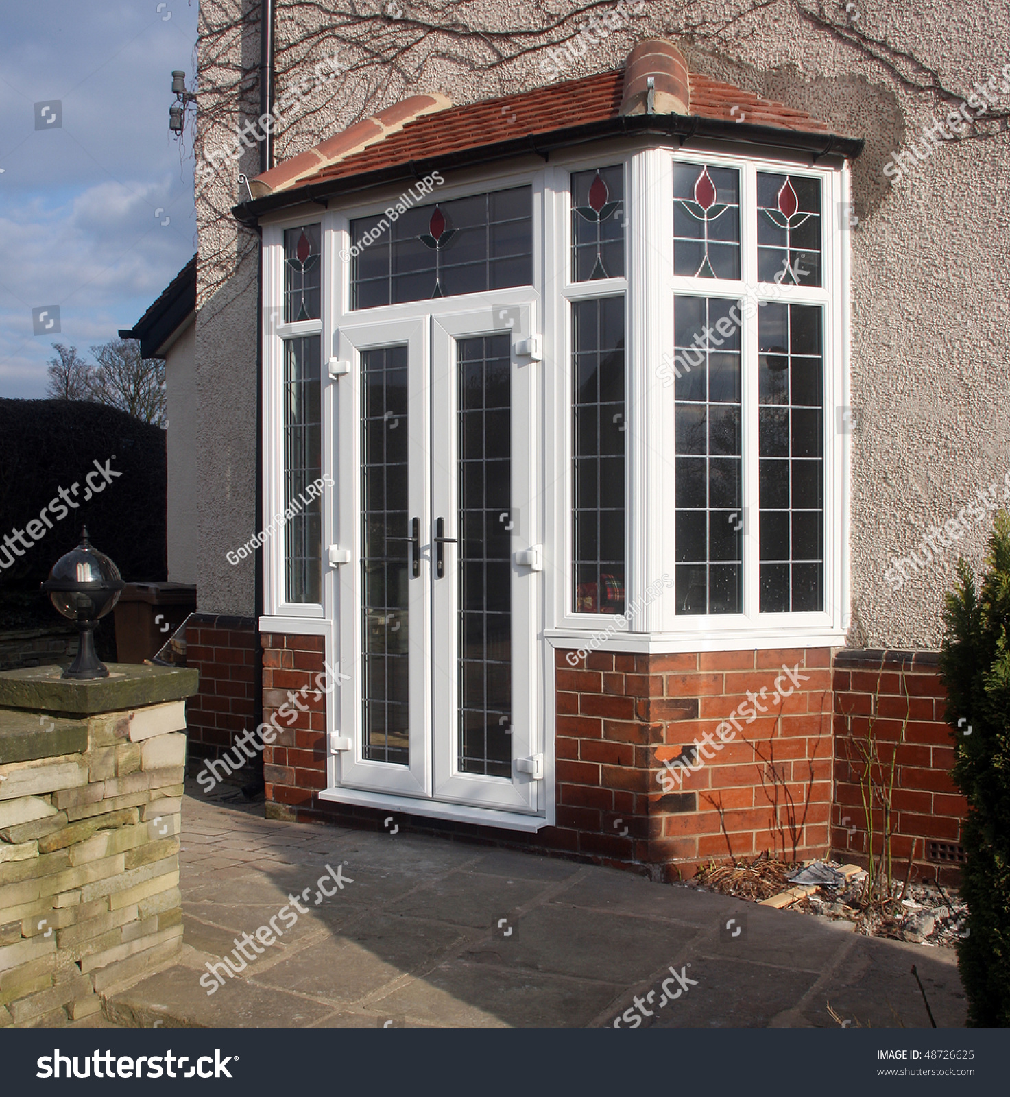 Upvc french doors fitted bay stock photo 48726625 for Upvc offset french doors