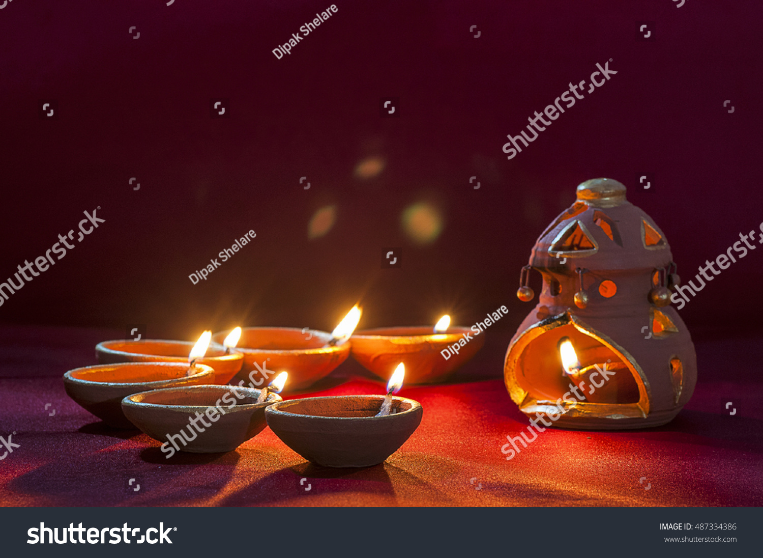 Clay diya lamps lit during Diwali Celebration Greetings Card Design Indian Hindu Light Festival called Diwali