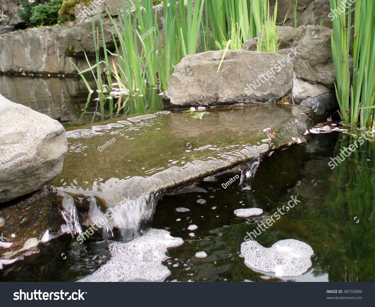 Decorative pond miniature waterfall stockfoto 48755896 for Ornamental pond waterfall