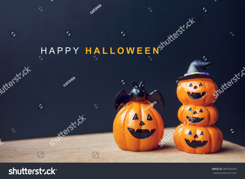 happy halloween message pumpkin on table stock photo (edit now