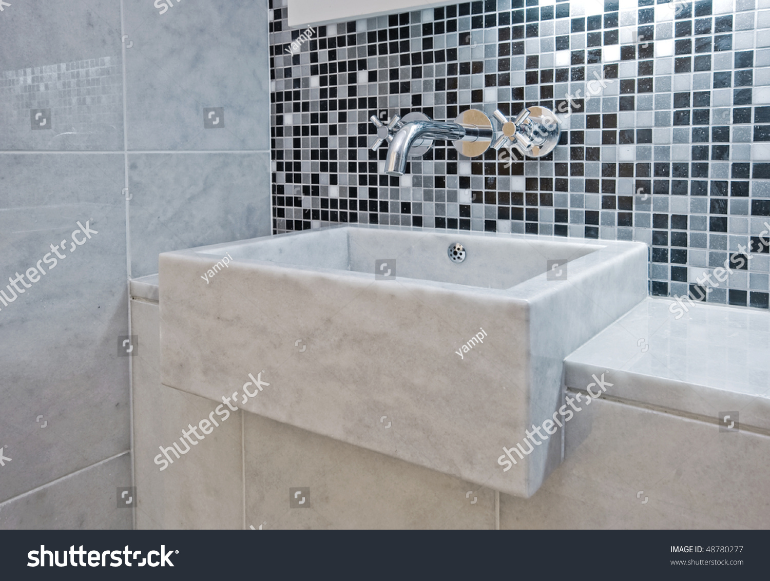 Luxury modern en suite bathroom with marble finish stock photo - Modern Luxury Hand Wash Basin Made Of Marble Stock Photo