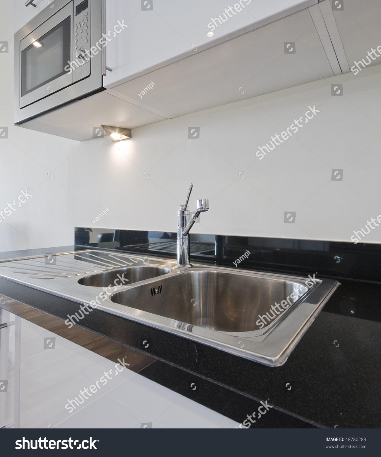 Stainless Steel Kitchen Sink On Black Stock Photo (Edit Now ...