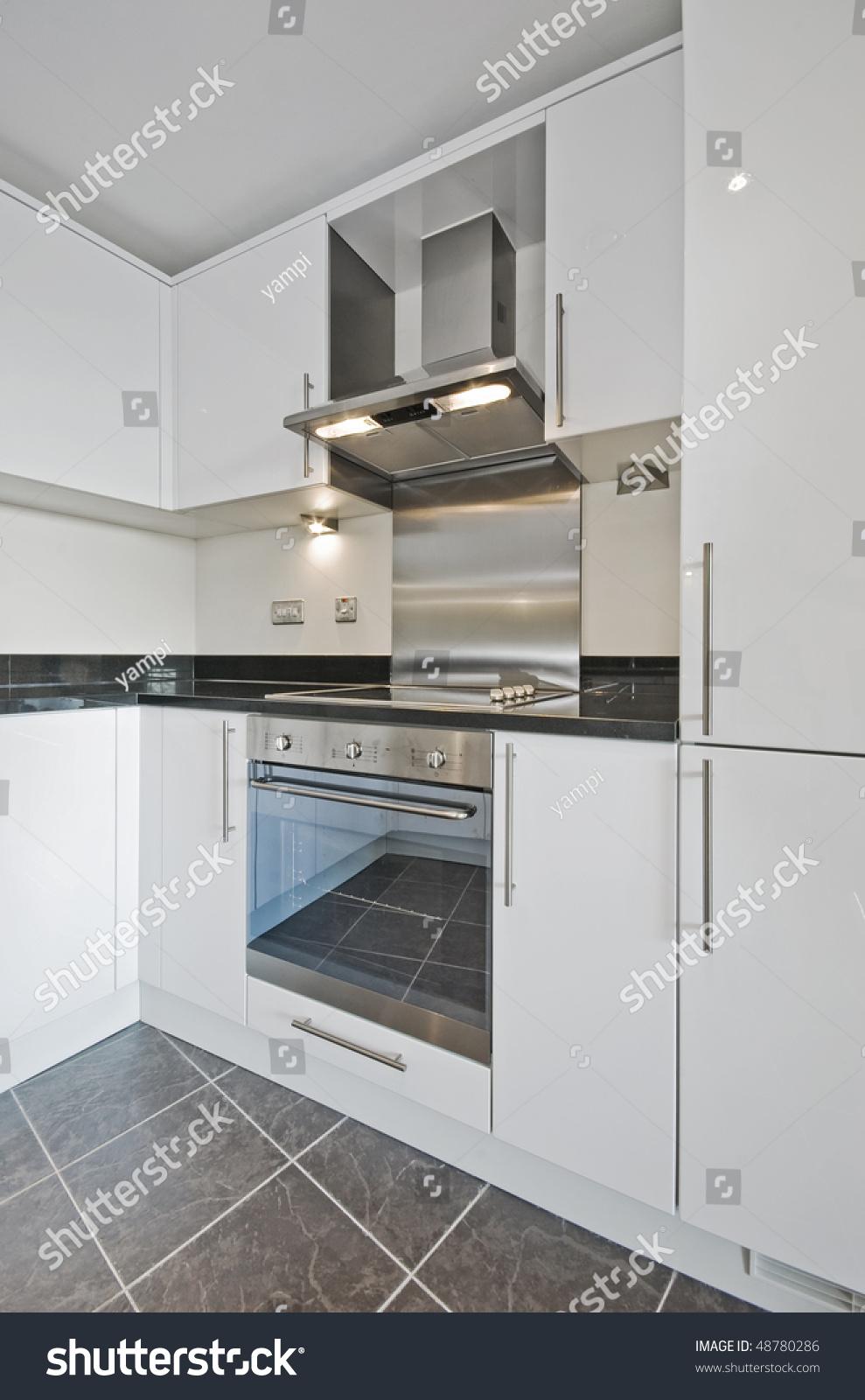 Modern White Kitchen Counter Black Granite Stock Photo