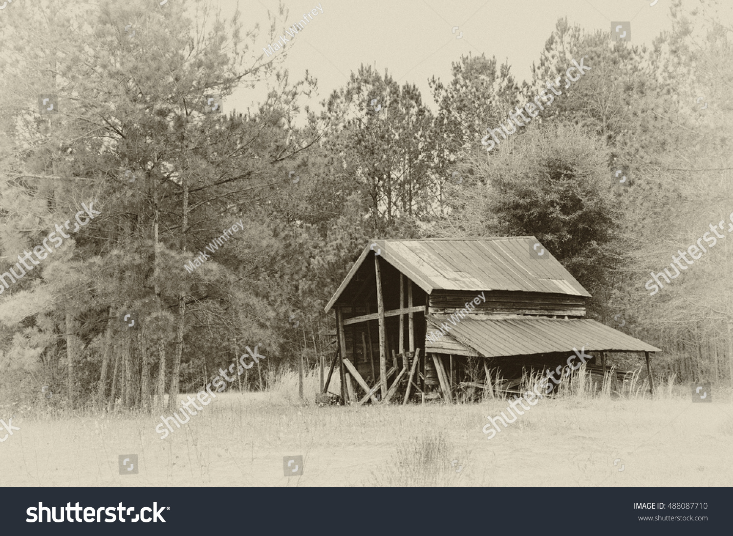 stock-photo-an-old-abandoned-barn-in-bla