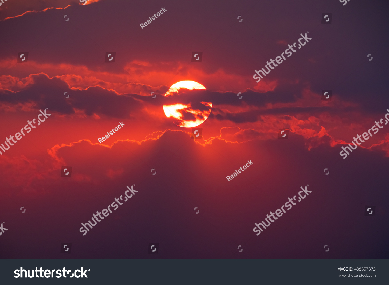 The picturesque red sunset with stormy cloud #488557873