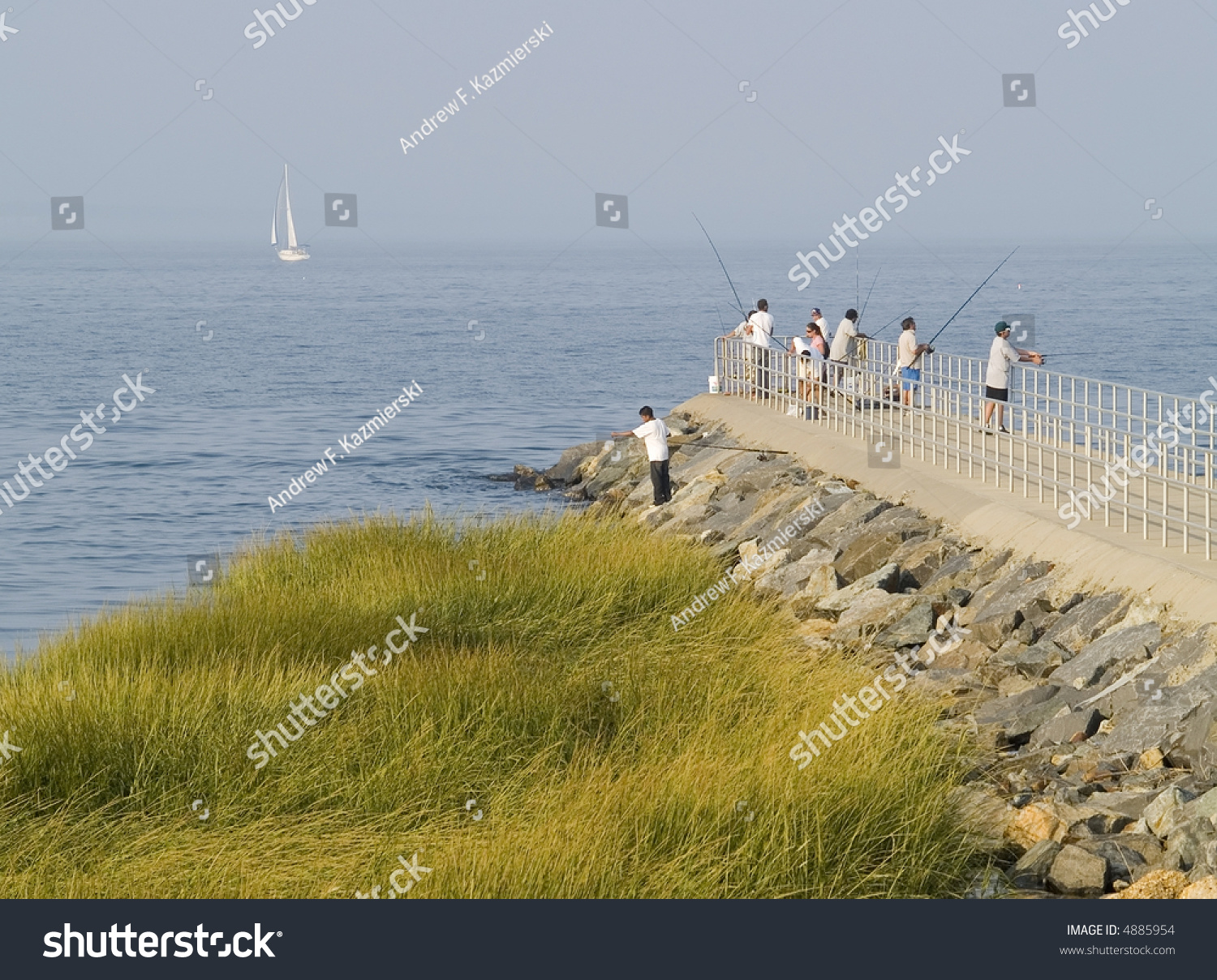 People fishing on hazy afternoon laurence stock photo for Nj shore fishing