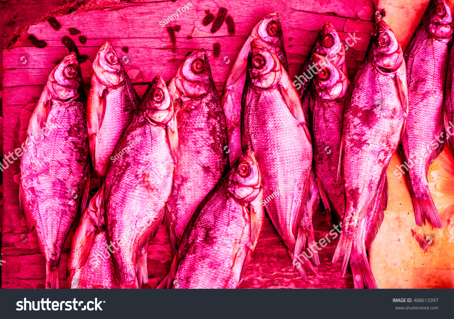 Royalty-free Dried fish on the table toned to color.… #488613397 ...