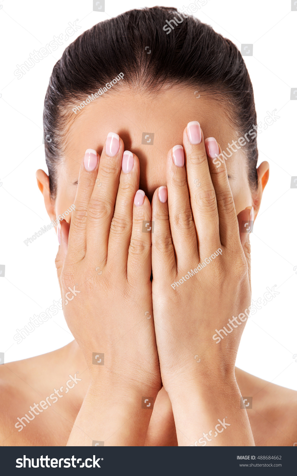 covering face with hands young woman covering her face her stock photo 488684662 1706
