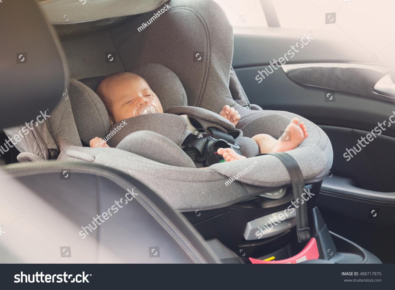 asian cute newborn baby sleeping modern stock photo   - asian cute newborn baby sleeping in modern car seat child new borntraveling safety on