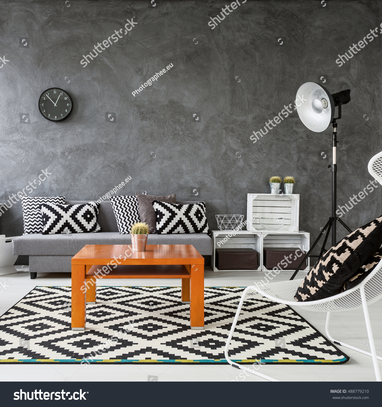 Living Room With Grey Walls And White Wooden Parquet Black Decorations Orange