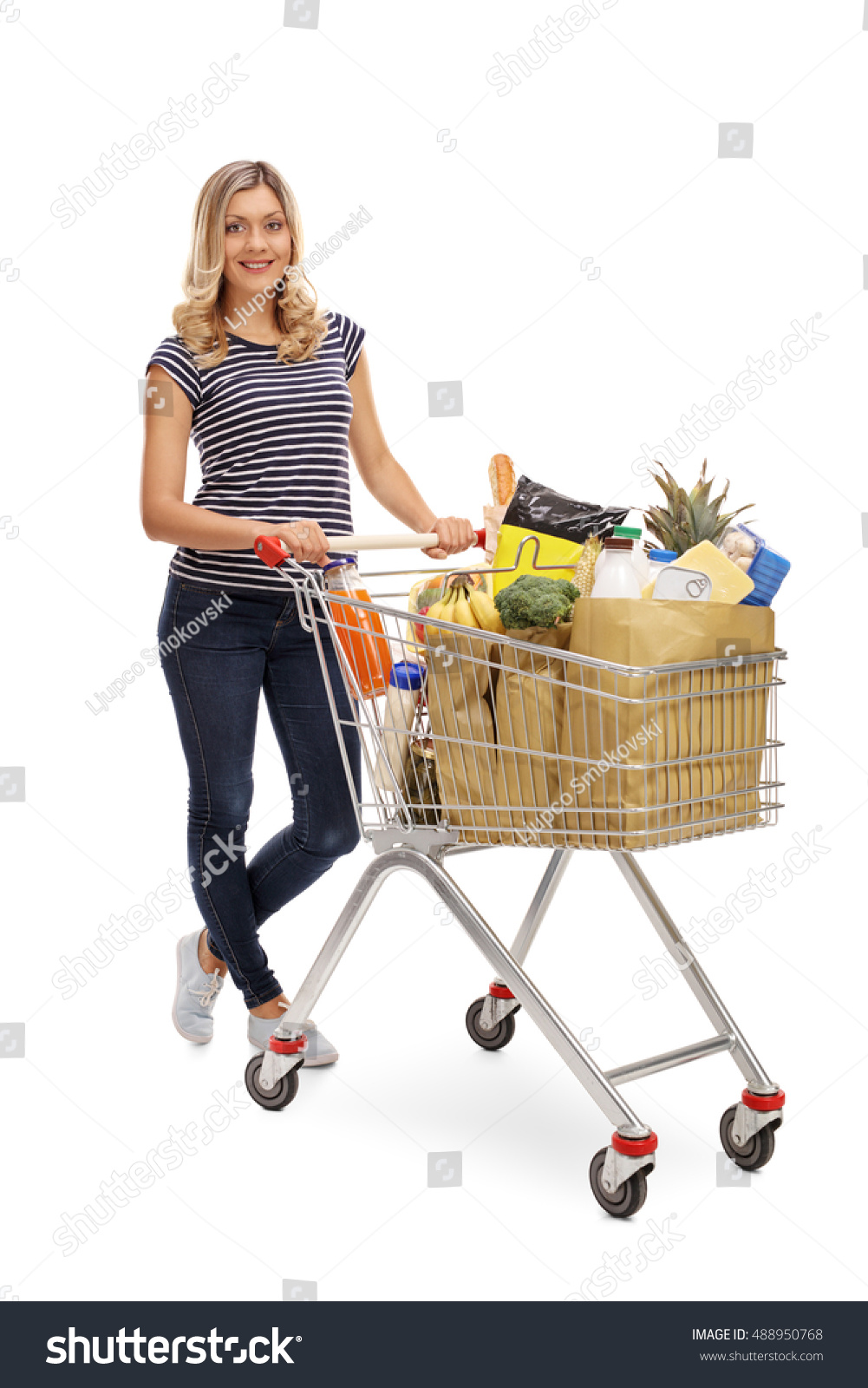 Woman posing with shopping bags isolated on white background full - Full Length Portrait Of A Woman Posing With A Shopping Cart Full Of Groceries Isolated On