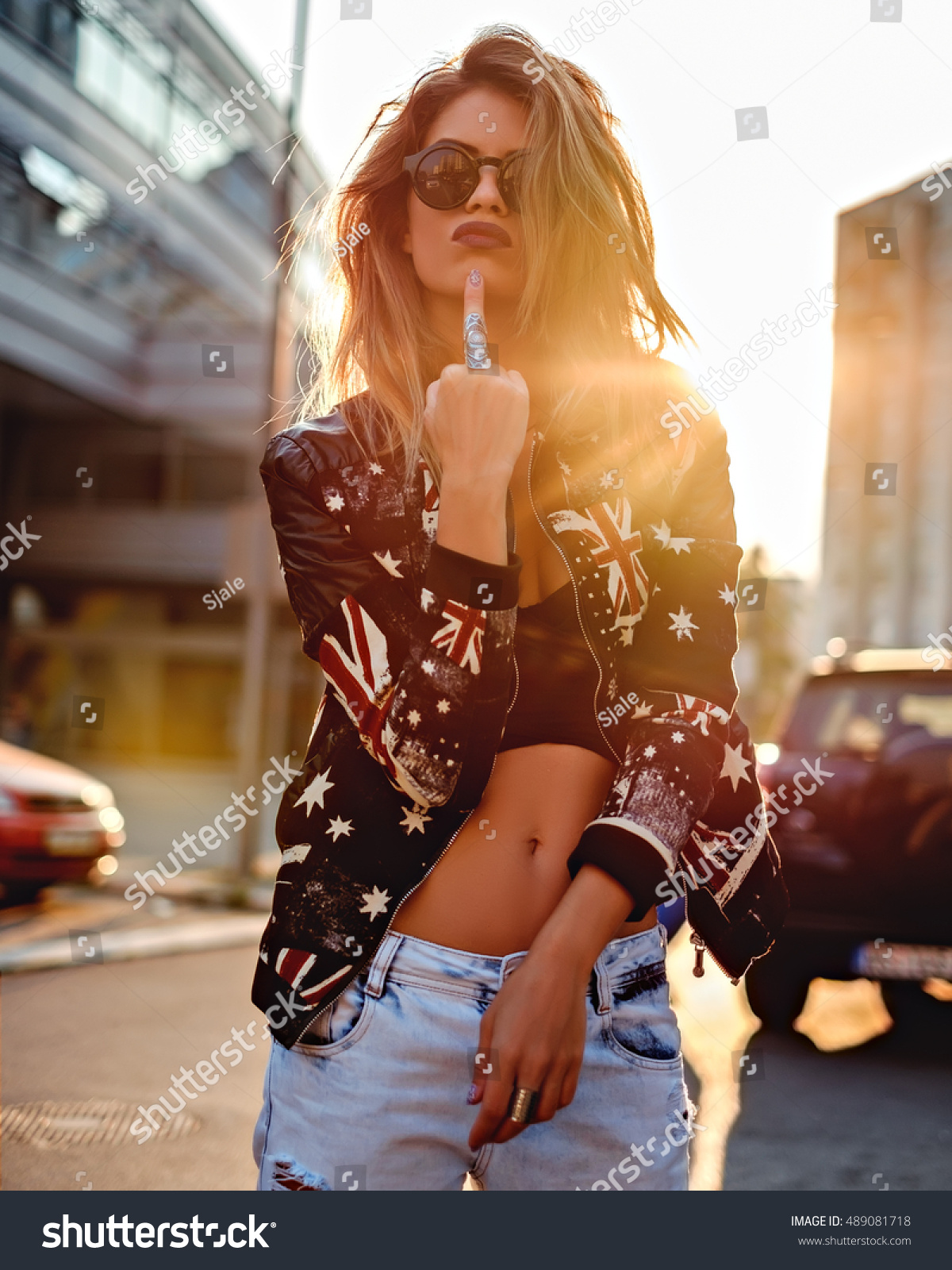 Sexy girl with attitude showing middle finger