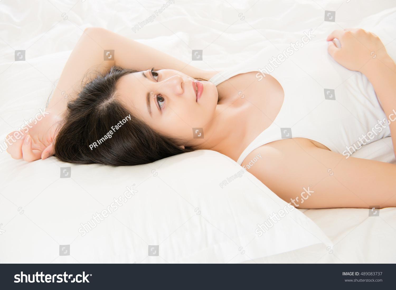 Beautiful Happy Asian Woman Lying On Stock Photo 489083737 - Shutterstock-2489