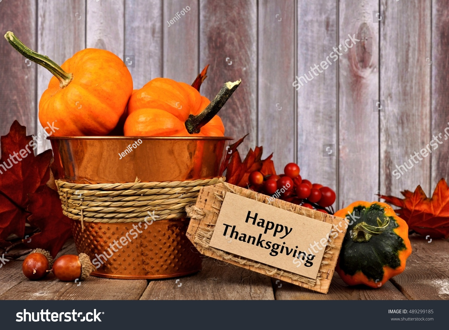 Happy Thanksgiving Tag Pumpkins Leaves And Autumn Home Decor With Rustic Wood Background