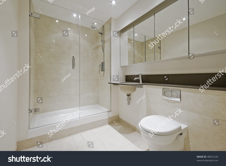Luxury Modern En Suite Bathroom With Floor To Ceiling Marble Tiles Stock Photo 48931243