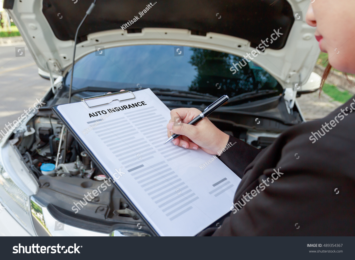 Insurance Agent Writing On Auto Insurance Stock Photo (Safe to Use ...