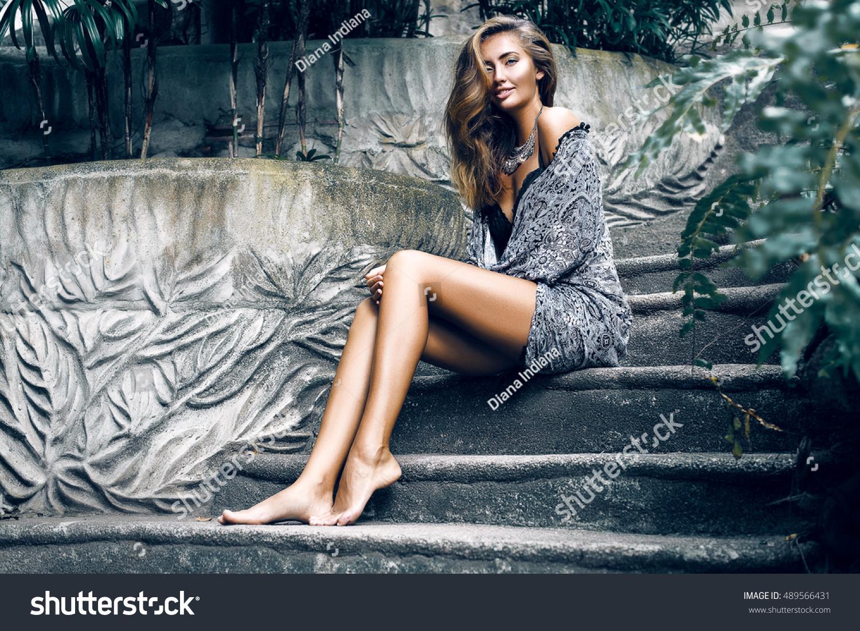 6044b0ffc Amazing young stylish woman sitting on stairs at grey boho dress,vintage  style,pure