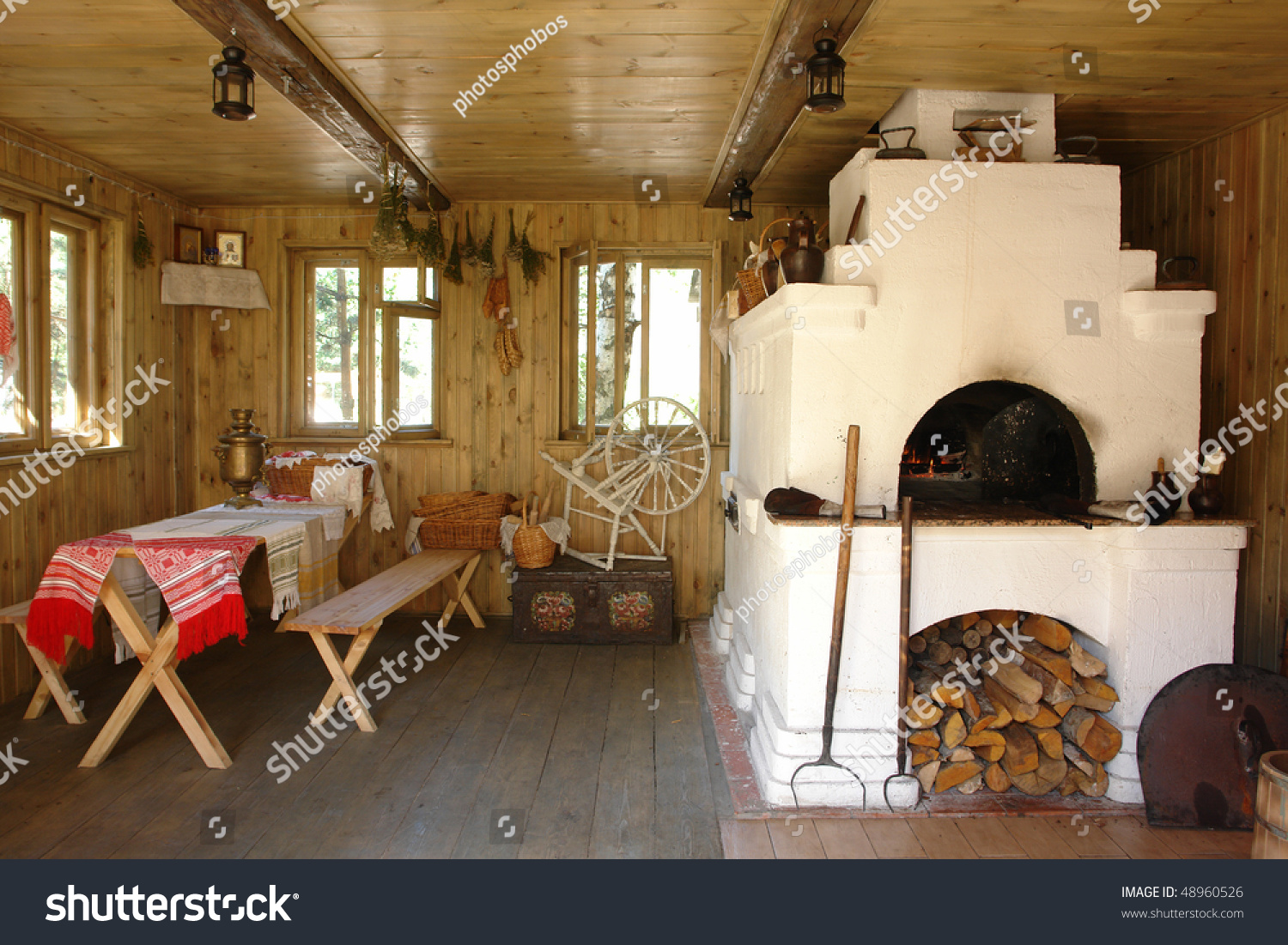 Interior Of Russian House With Traditional Oven Stock