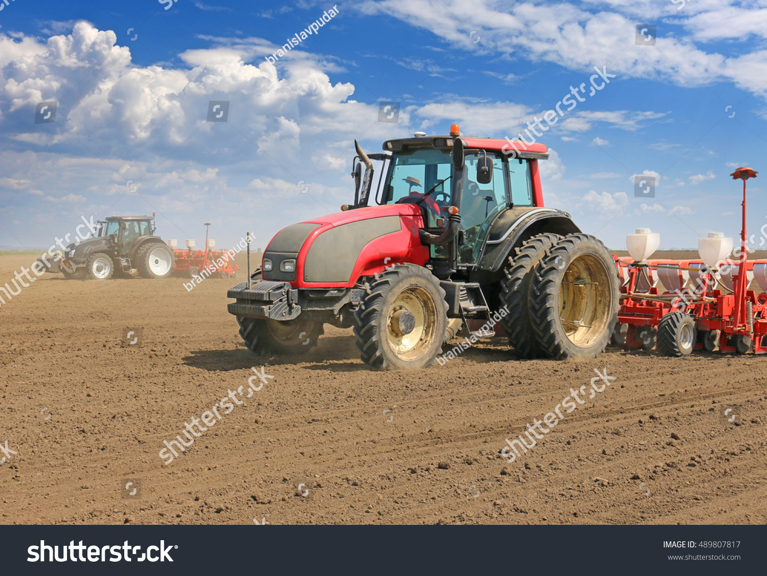 Tractor In Field Planting : Tractor and seeder planting crops on a field stock photo