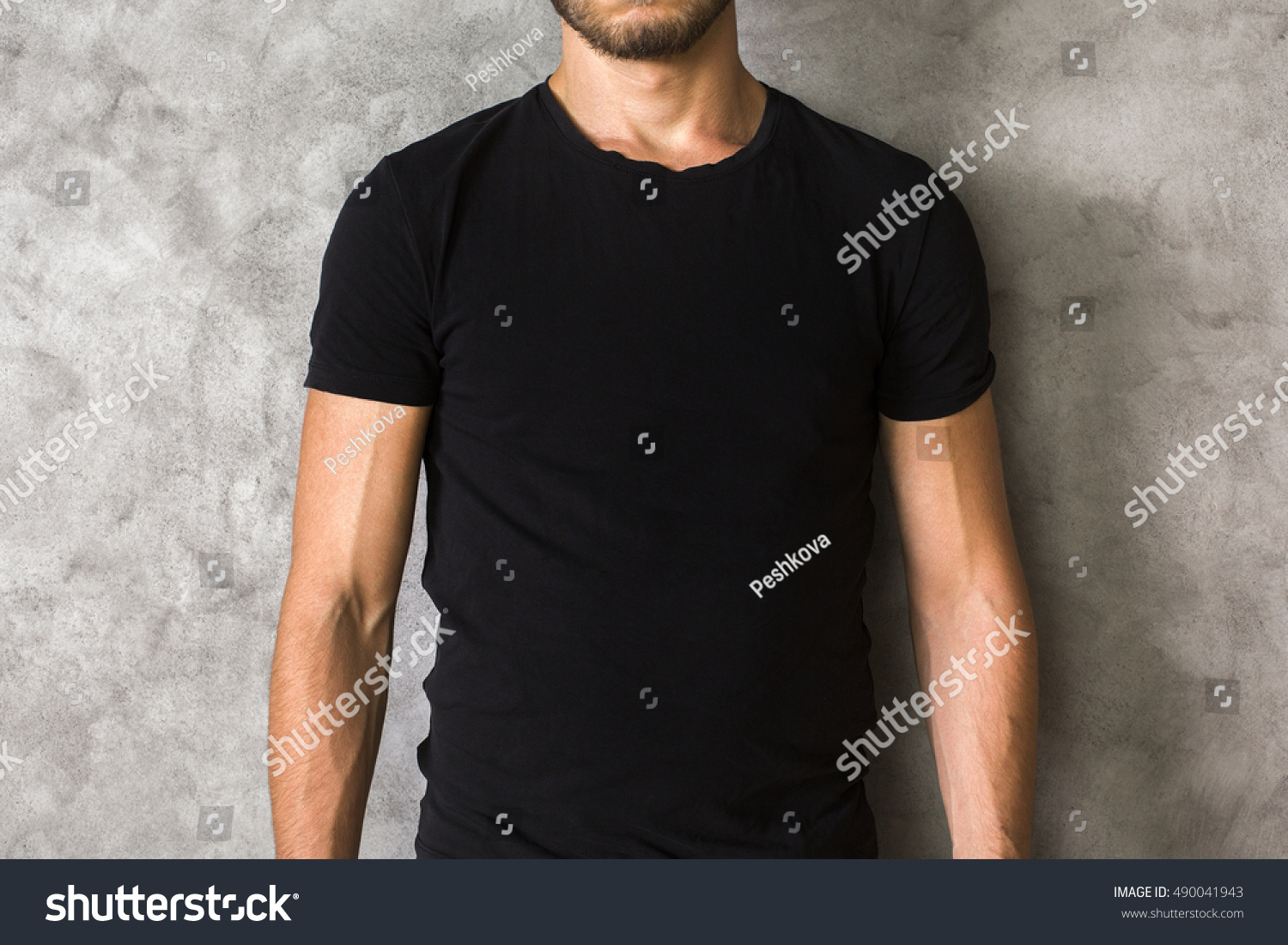 Black t shirt photo - Closeup Of Young Man S Body In Empty Black T Shirt On Textured Concrete Wall Background