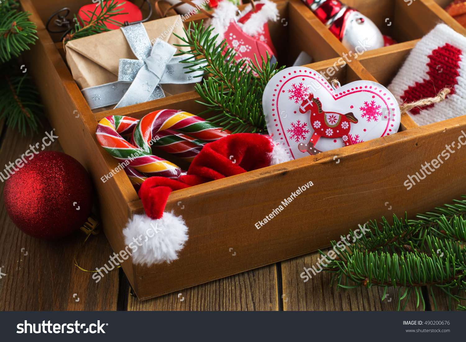 traditional christmas decoration with evergreens and poinsettia candle and star shaped cinnamon cookies zimtstern ez canvas - Wooden Box Christmas Decorations