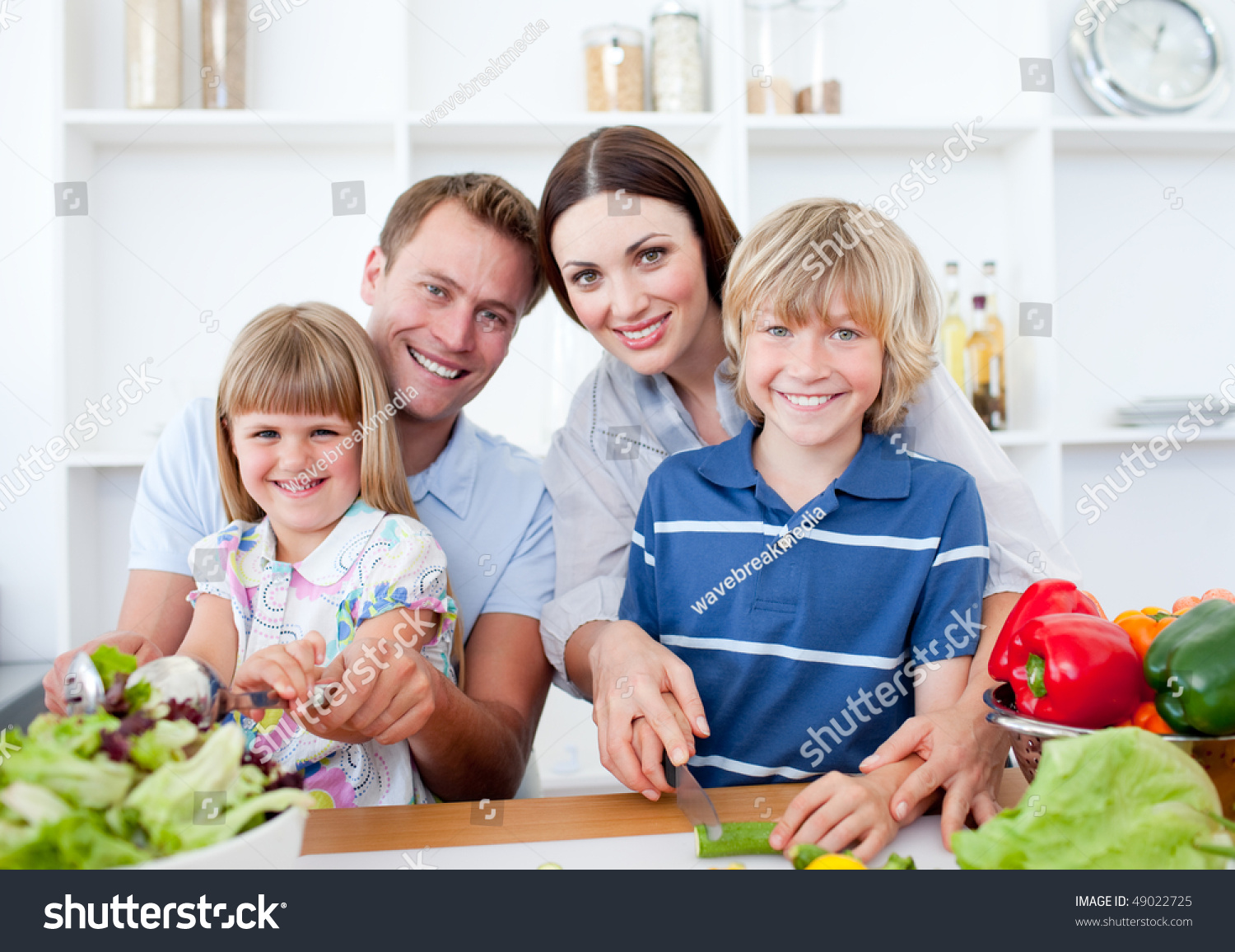 happy family preparing dinner together in the kitchen stock photo, Kitchen design
