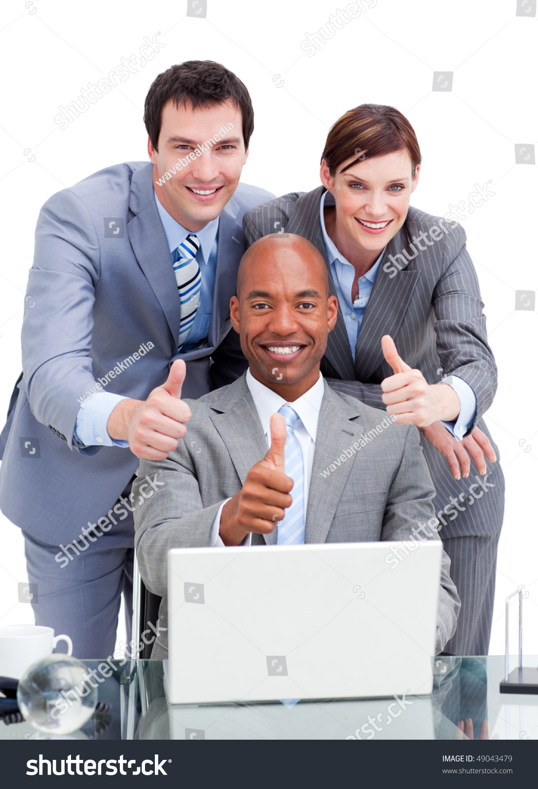 Diverse Business Co-Workers With Thums Up At A Laptop In ...  Diverse Busines...