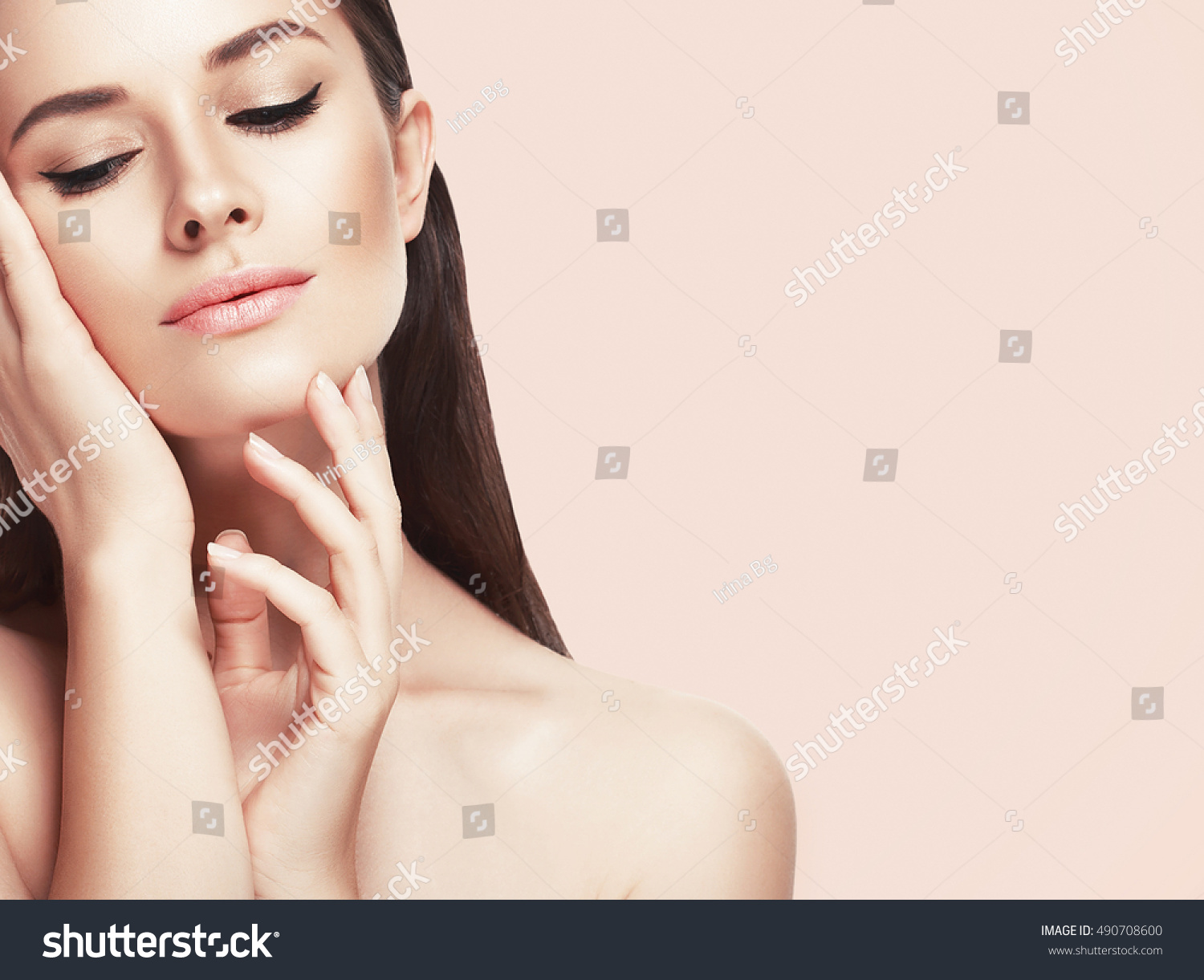 Beautiful woman face close up studio on pink  #490708600