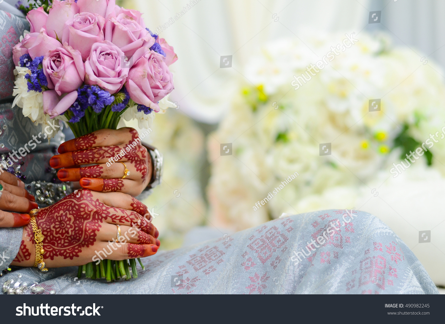 Hands of Bride With Flower bouquet Malay Wedding Dress And Bouquet Of Flowers Selective Focus And Shallow DOF