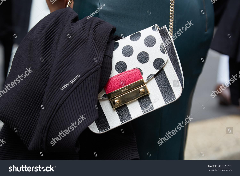 MILAN SEPTEMBER 22 Woman with black and white Furla bag before Anteprima fashion show Milan Fashion Week street style on September 22 2016 in Milan