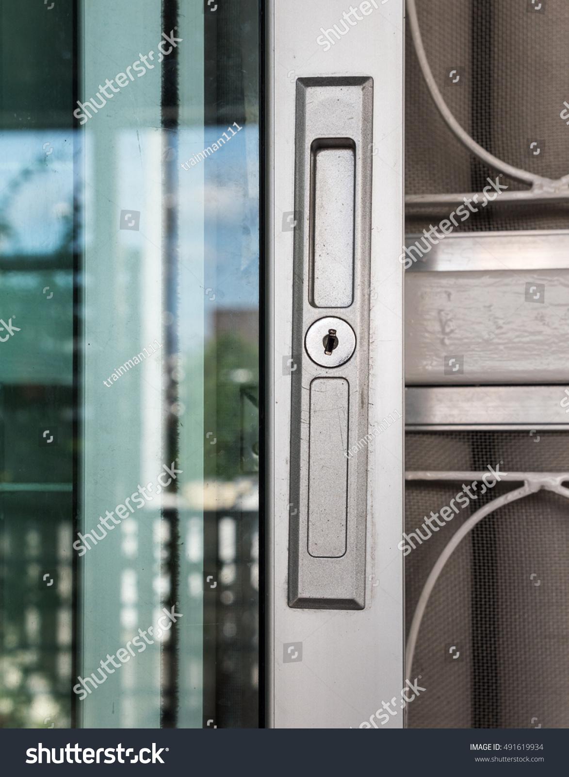 Keyhole On Metal Frame Glass Door Stock Photo Edit Now 491619934