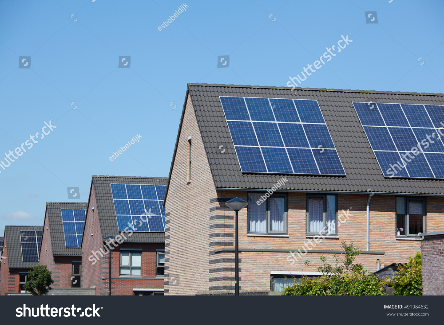 Modern Houses With Solar Panels On The Roof For