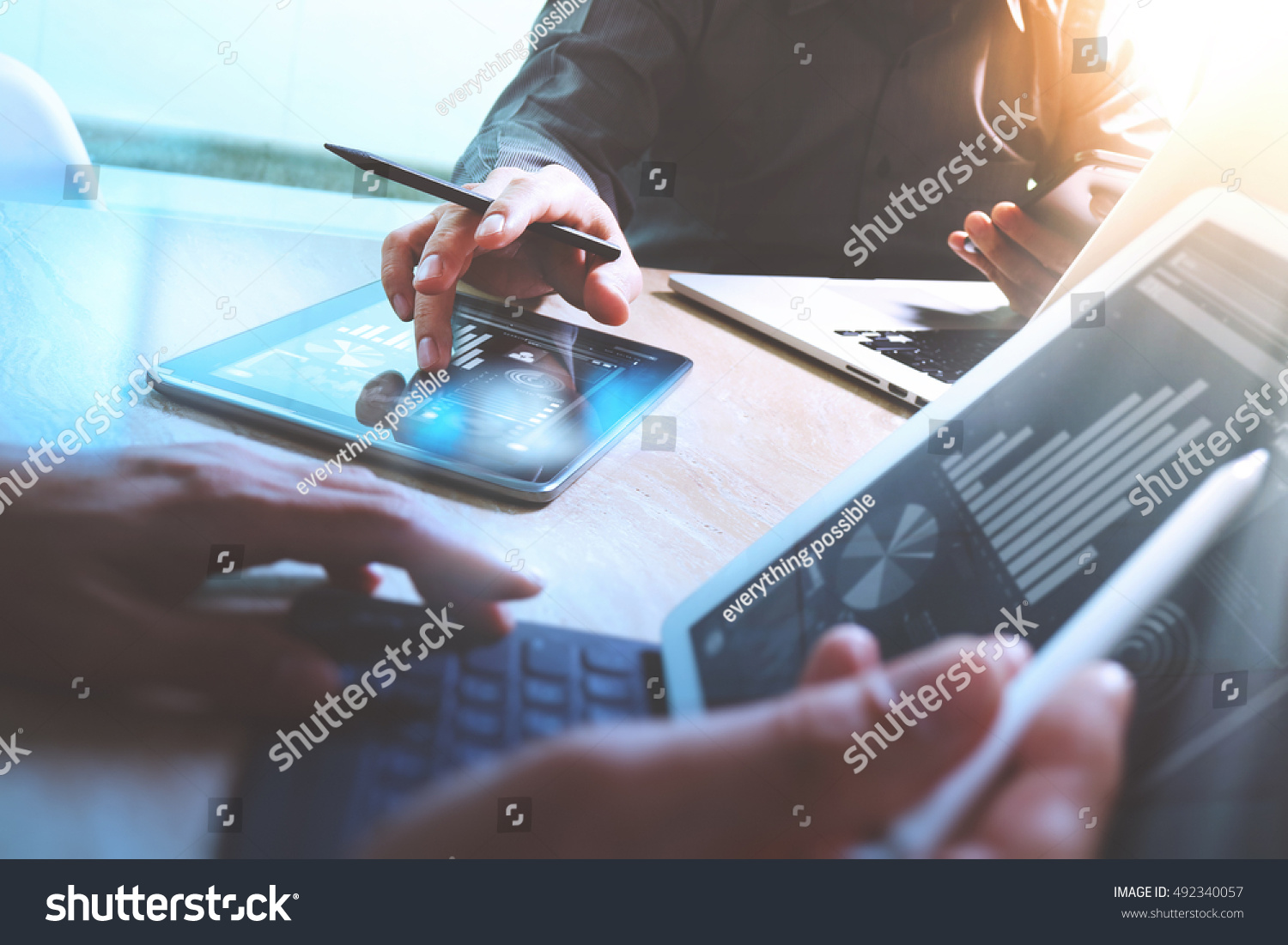 Business team present. Photo professional investor working new startup project. Finance meeting.Digital tablet laptop computer  smart phone using, keyboard docking screen foreground,filter #492340057