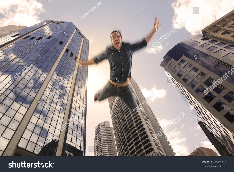 Building Falling Down : Young man falling down building city stock photo